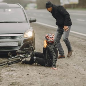 Road accident with cyclist man driver and car